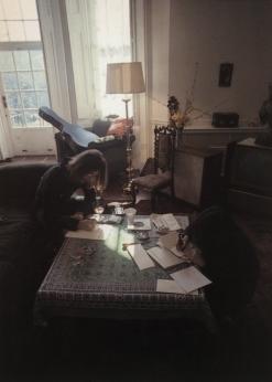John Lennon & Yoko Ono at work in their home (Image via Fromyourdesk.com)
